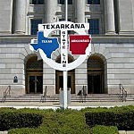 Texarkana's State Line sign in front of downtown post office