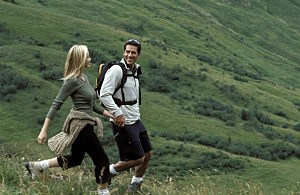 Man and woman hiking on mountainside