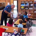 Fire Marshal Chris Black reads Fire Truck to students at Nash Elementary