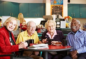 Senior adults drinking coffee together