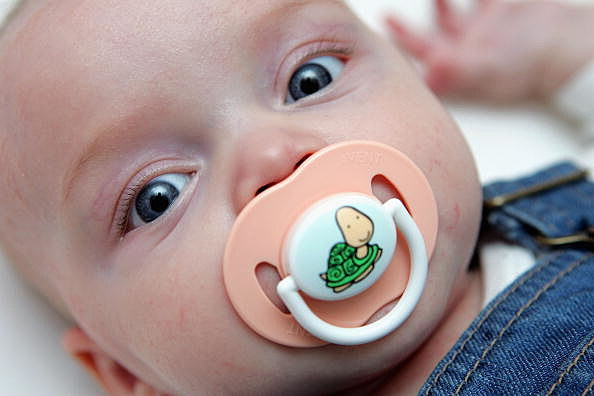 Little girl with pacifier