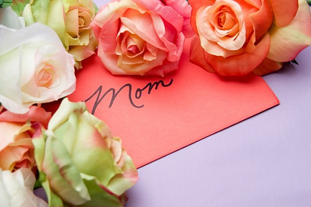 Card with word Mom and flowers