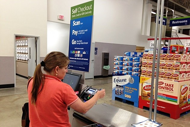 Heather Fink uses Sam's Club's new self check service