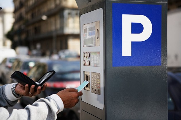 Man Paying Electronic Parking Meter