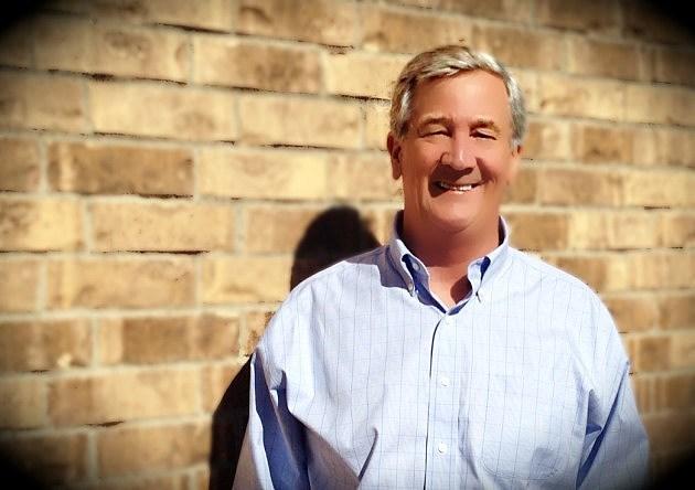 Ron Bird with brick background