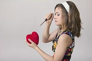 Woman stabbing heart