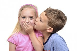 Boy Kissing Girl - kreinick/ThinkStock