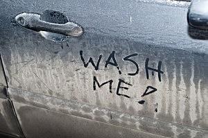 Wash me sign on dirty car - Piotr Sikora/ThinkStock