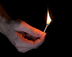 adult man hand holding matchstick - GooDween123/ThinkStock
