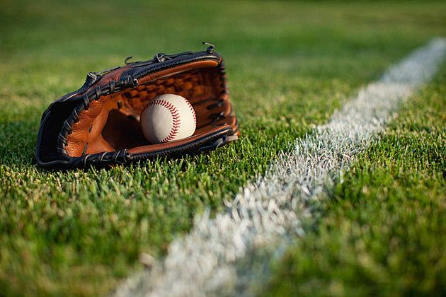 Baseball mitt and ball in grass with selective focus