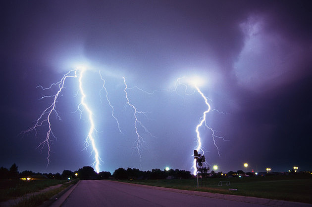 tungsten shot of a bolt of lightning hitting the ground