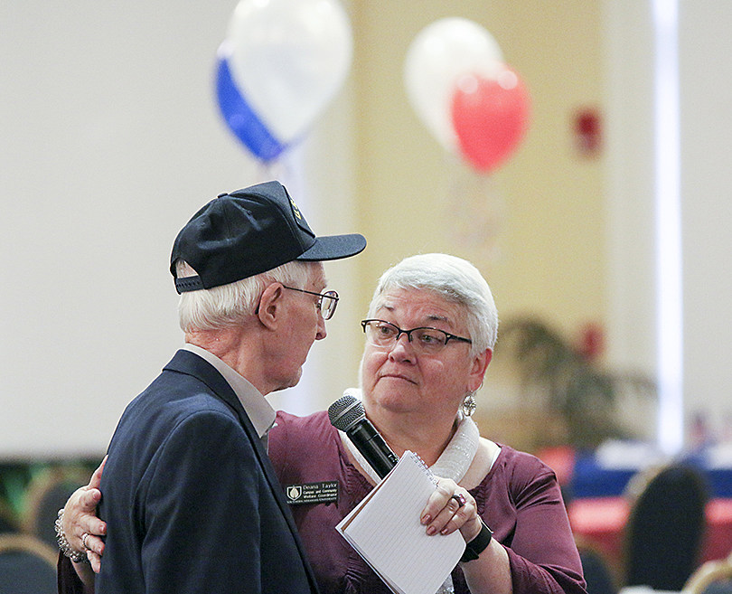 Deana Taylor allows veterans to introduce themselves during the annual Veterans Day Tribute at Southern Arkansas University.