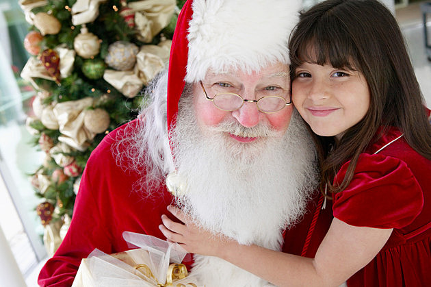 Portrait of a Young Girl With Her Arm Around Father Christmas